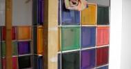 Kleurige badkamer met glasblokken in Amstelveen